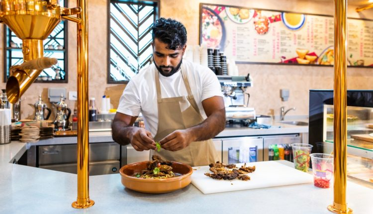 The chef at S34 Gahwa Mezza Bar in DXB prepares a dish from the inspiring menu.